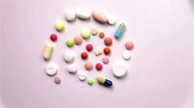 stock-footage-spiral-made-of-different-colorful-pills-spinning-in-circle-full-hd